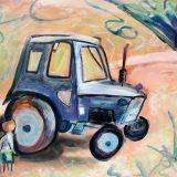 Petit en admiration face au tracteur
